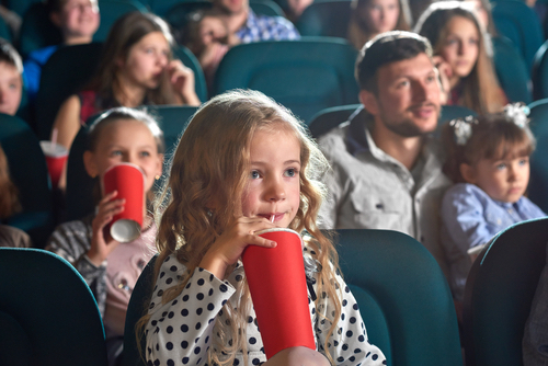 Children Seated In A Theater