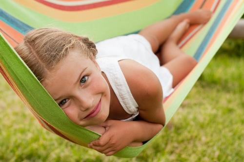 Girl relaxes in hammock