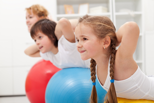 Children Exercise On Large Rubber Balls