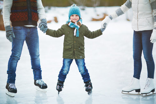 Parents And Child Ice Skating