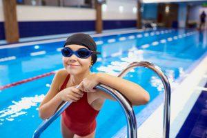 Girl posing in an indoor pool