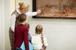 Adult showing children artwork