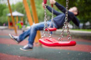 Child swings on swing set