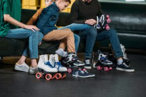 Parent and child change into roller skates