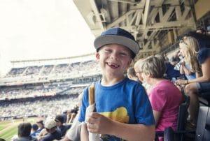 Boy enjoys a baseball game at the stadium